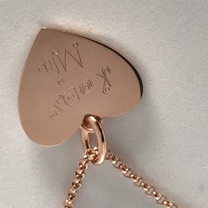 hand written names engraved on necklace