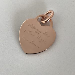 Handwriting engraved on a pendant