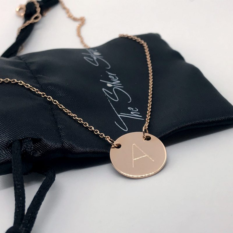 rose gold suspend disc engraved with letter A