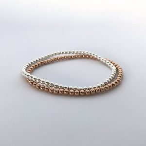 silver and rose gold stretch bead bracelet