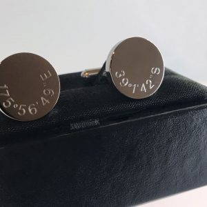 cufflinks engraved with coordinates of special place