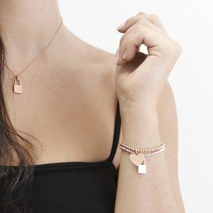 stretch bead bracelets with heart and padlock pendants