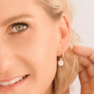 sterling silver mini disc hoop earring closeup