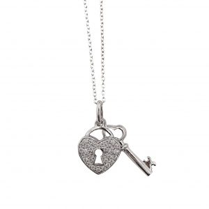 sterling silver key and padlock pendant worn on cable chain