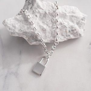 silver bracelet with engraved lock pendant