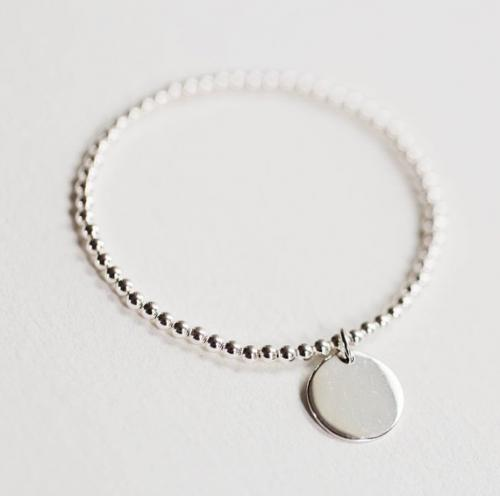 silver bead bracelet with engraved disc pendant