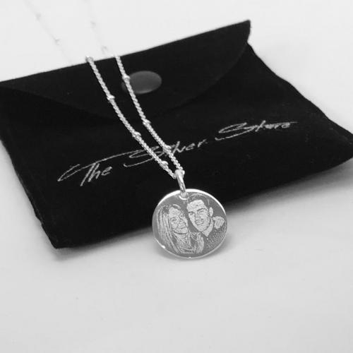 couple photo engraved on necklace