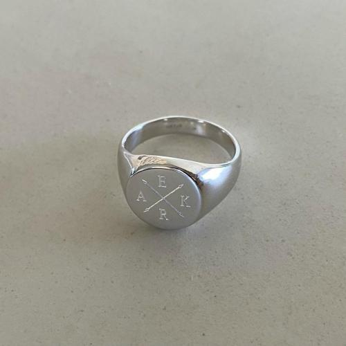 mens signet ring engraved with crossed arrows and 4 initials