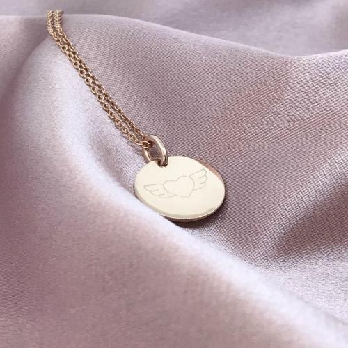 ecklace with winged heart engraved