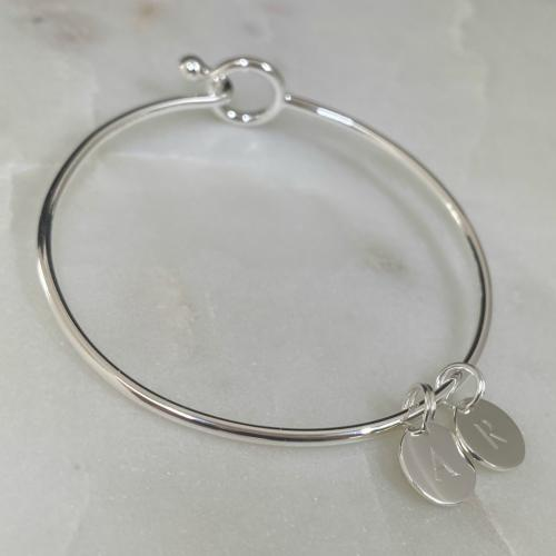 sterling silver opening bangle with mini disc pendant engraved with initials